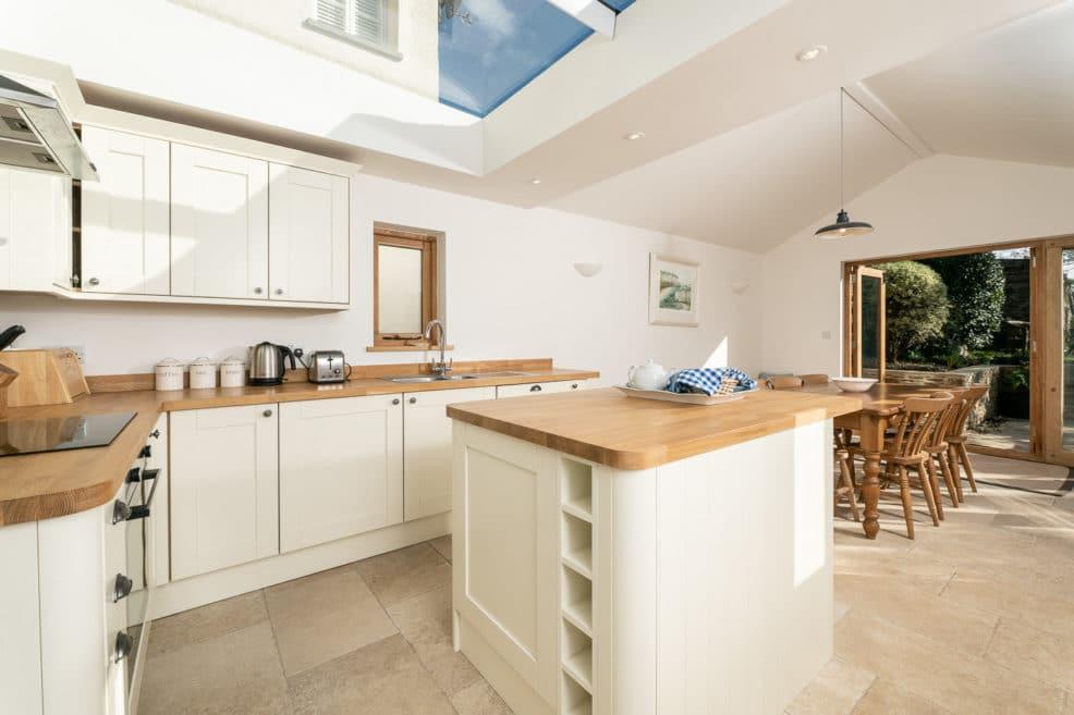 Sunlit open plan kitchen diner - property photography
